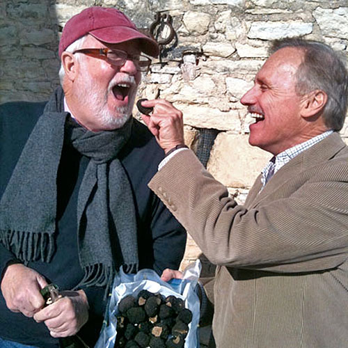 Two men sharing bag of roasted nuts in winter Burgundy France