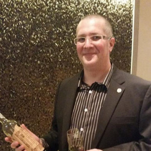 Wine expert man holding wine bottle Arnaud Cagni